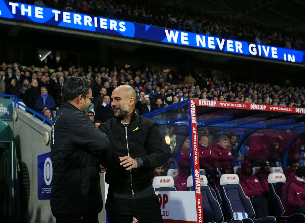 Huddersfield Town manager David Wagner shakes hands with counterpart Pep Guardiola of Manchester City, Premier League 2017