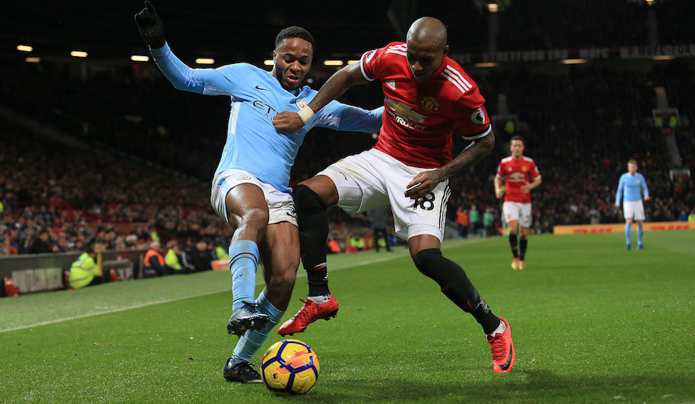 Raheem Sterling of Manchester City is tackled by Ashley Young of Manchester United, Premier League 2017