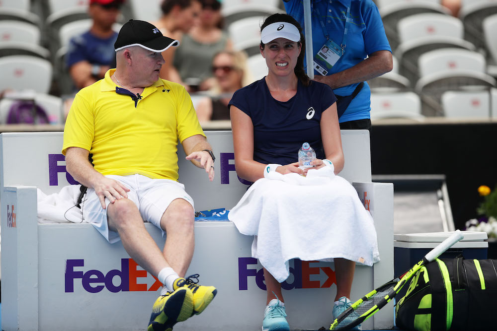 Johanna Konta speaking with Michael Joyce in the first round of the Sydney International, 2018