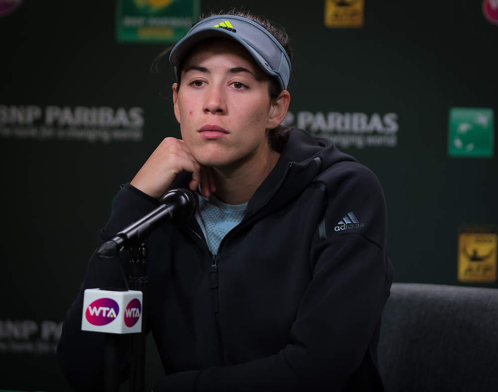 Garbine Muguruza talks to the press after losing in the second round of the BNP Paribas Open, WTA Indian Wells 2018