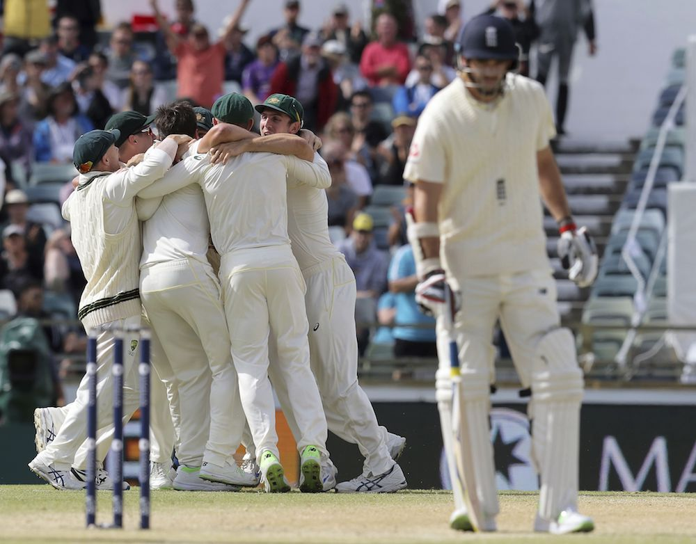 Australian players celebrate the dismissal of Chris Woakes to win the third Ashes cricket test match in Perth, Australia 2017