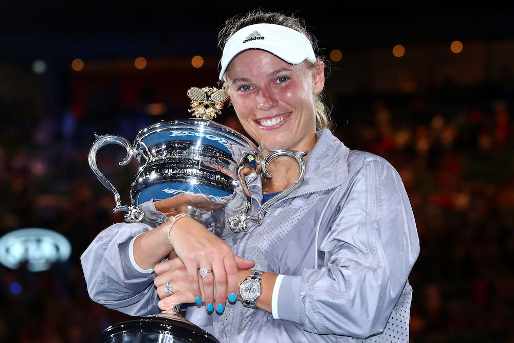 Caroline Wozniacki with the Daphne Akhurst Memorial Cup after winning the women's singles final after winning the Australian Open, 2018