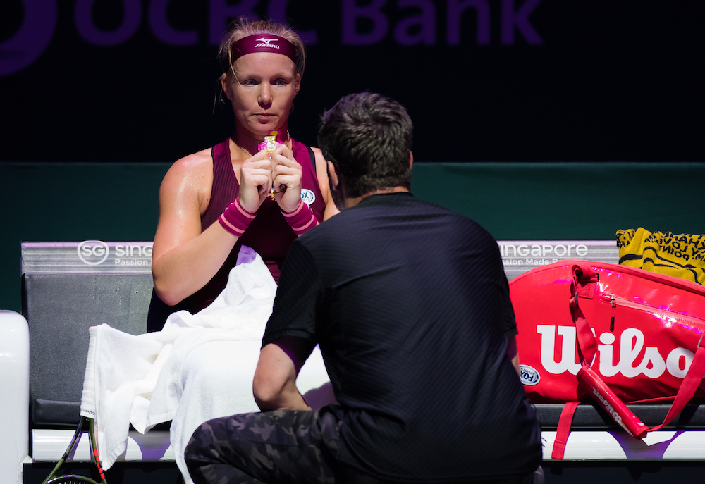 Kiki Bertens & Raemon Sluiter in the first round-robin match of the WTA Finals 2018, Singapore
