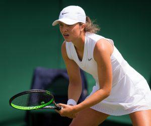 Iga Swiatek in the first round of Wimbledon 2019