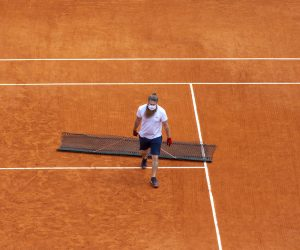 Clay Court being swept